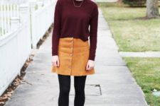 With marsala shirt, black tights and black shoes
