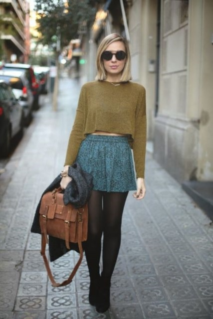 With mini skirt, heels, cardigan and brown bag