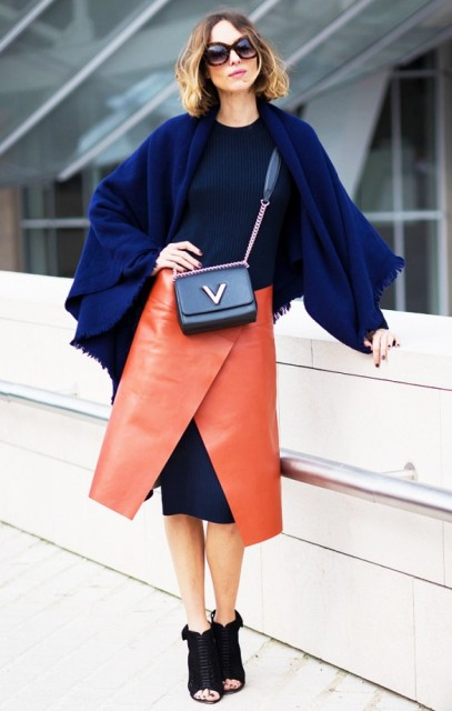 With navy blue dress, crossbody bag and cutout boots