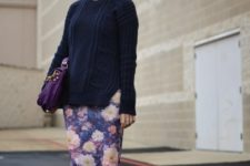With navy blue long sweater, purple bag and black pumps