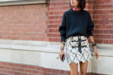 With navy blue loose sweater
