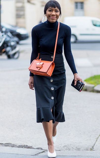 With navy blue shirt, white shoes and orange crossbody bag
