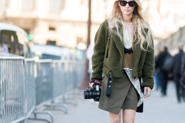 With olive green jacket, shirt and sunglasses