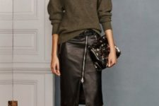 With olive green loose sweater, ankle strap shoes and clutch