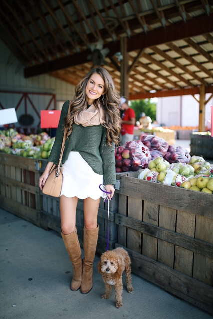 With olive green sweater, beige bag, suede high boots and scarf