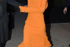 With orange maxi dress