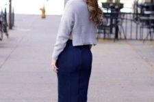 With pencil skirt and blue boots