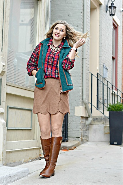 With plaid button down shirt, vest and brown leather boots