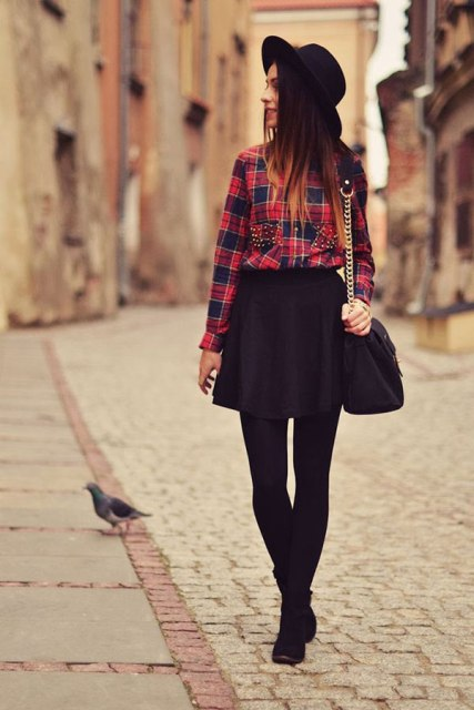 With plaid shirt, black wide brim hat, black bag and boots