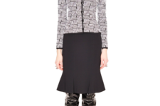 With printed shirt and leather over the knee boots