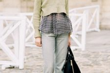 With printed shirt, gray trousers, black boots and black bag