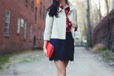 With printed shirt, white jacket, black flats and red clutch