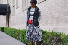 printed sweater with a zebra skirt is a trendy mix