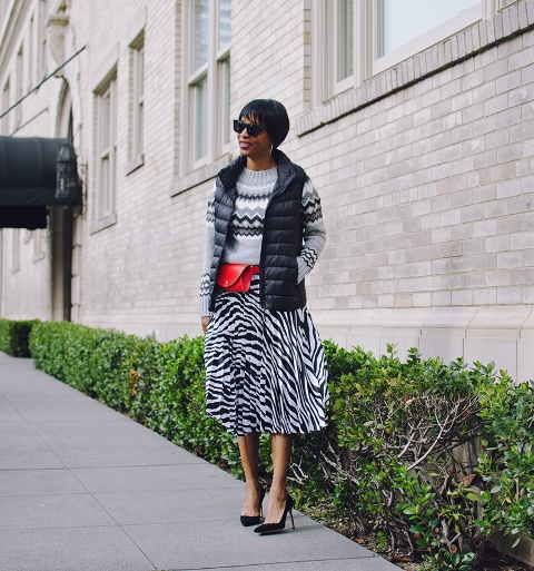 With printed sweater, red waist bag, vest and pumps
