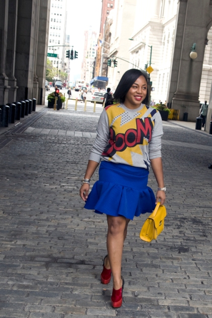 With printed sweatshirt, yellow bag and red shoes