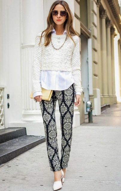 With printed trousers, white shirt, beige clutch and white shoes