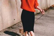 With red oversized sweater and leopard shoes