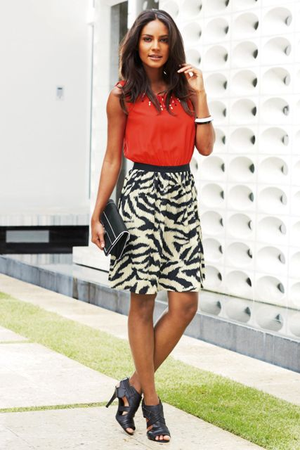 With red top, clutch and cutout shoes
