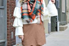 With ruffled blouse, plaid scarf and brown high boots