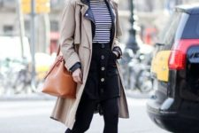 With striped shirt, trench coat, brown bag and boots