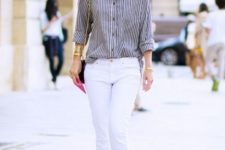 With striped shirt, white pants and chain strap bag
