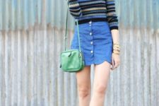 With striped sweater, green bag and light blue sneakers