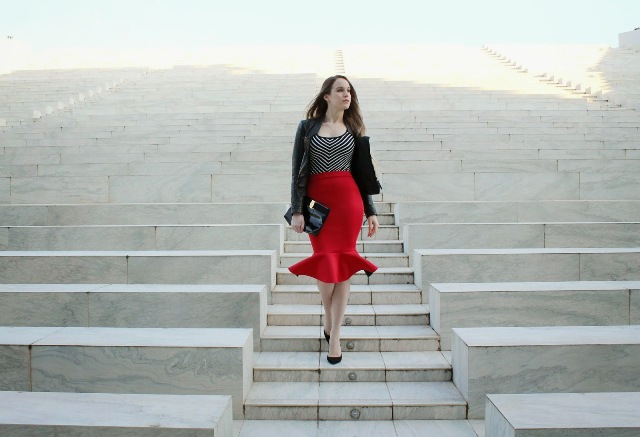 With striped top, black jacket, black clutch and black shoes