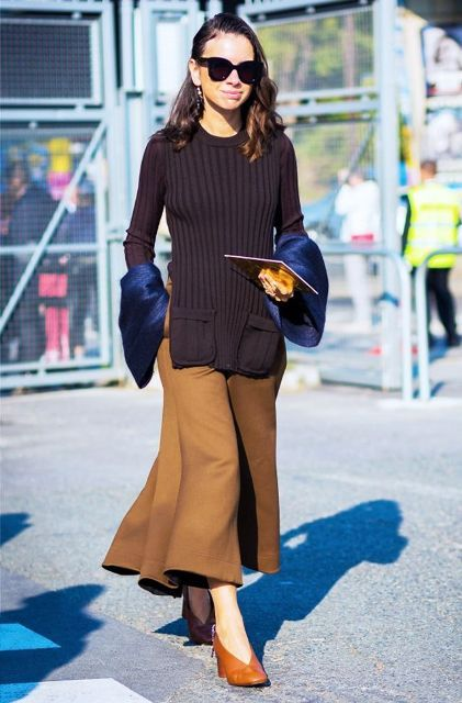 With sweater, culottes and sunglasses