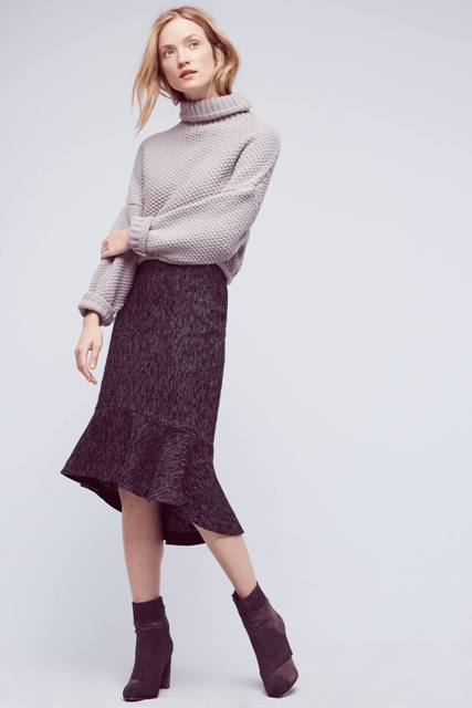 With turtleneck sweater and suede ankle boots