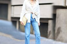 With unique shirt, clutch and loose jeans