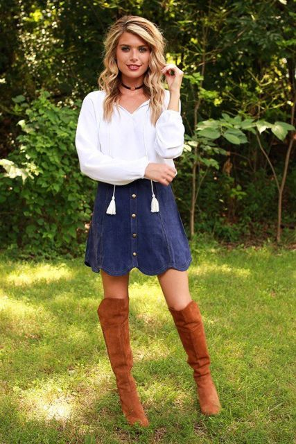 With white blouse and brown suede over the knee boots