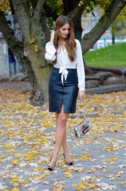 With white blouse, leopard bag and black and leopard pumps