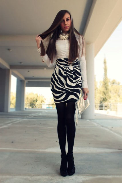 With white button down shirt, metallic clutch, black tights and black boots
