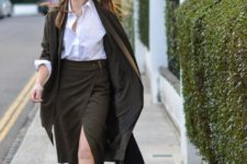 With white button down shirt, midi coat and black mules