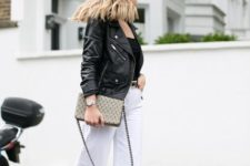 With white culottes, black leather jacket, black top and printed bag