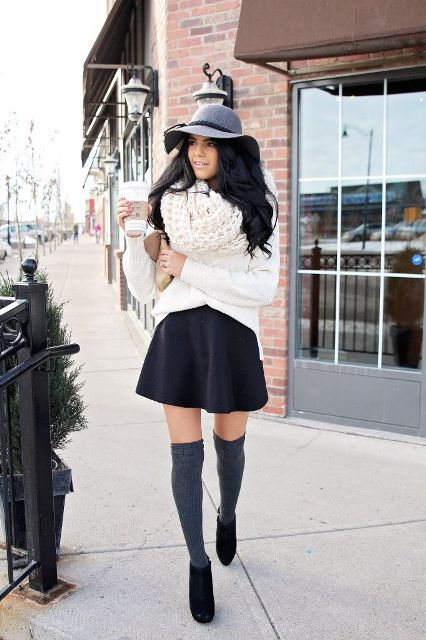 With white loose sweater, white oversized scarf, gray wide brim hat, gray socks and black boots