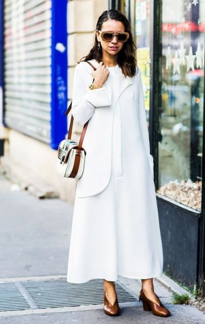 With white maxi dress, white blazer and two colored bag