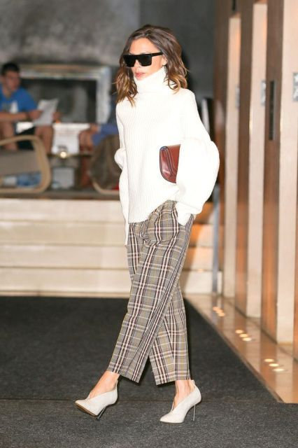 With white oversized sweater, brown clutch and checked trousers