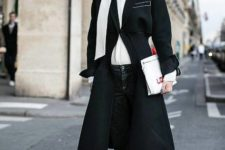 With white shirt, black coat, jeans and white clutch