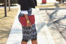 With white shirt, black crop jacket, red clutch and cutout shoes