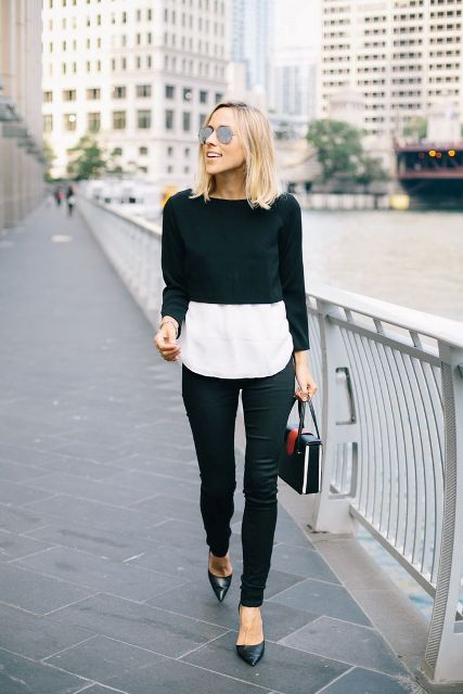 With white shirt, black pants, black shoes and small bag