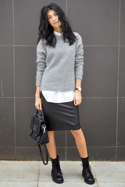With white shirt, gray sweater, black bag and lace up boots