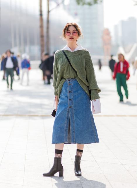 With white shirt, olive green sweater, socks and ankle boots