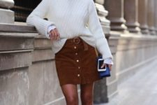 With white sweater and velvet boots