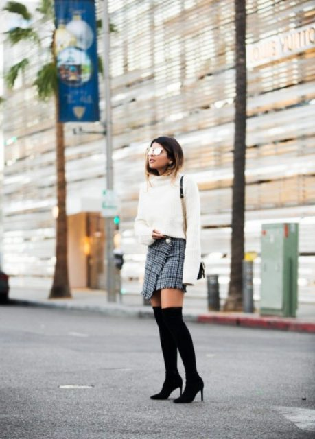 With white sweater, black bag and over the knee boots