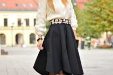 With white sweater, hat and black pumps
