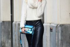 With white sweater, white sneakers and metallic bag