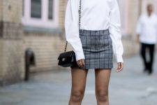 With white sweatshirt, checked mini skirt and mini bag