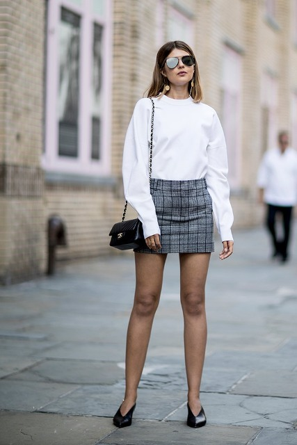 With white sweatshirt, checked mini skirt and mini bag