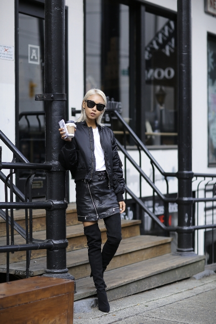 With white t-shirt, black jacket and over the knee boots
